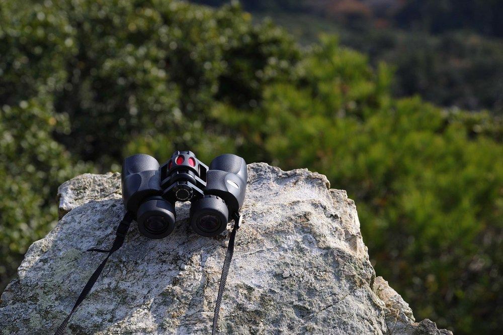 binoculars on a rock